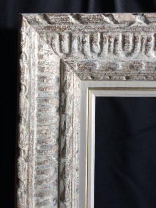 Détail d'un cadre restauré par l'atelier Les Baguettes Magiques à Lyon Croix-Rousse